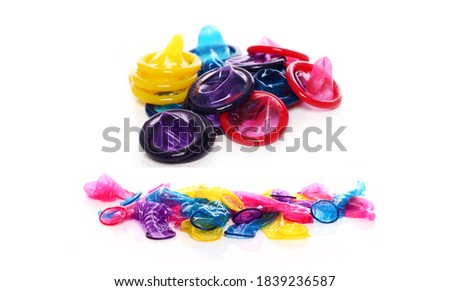 Close up of colorful condoms isolated