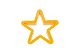 Close-up of colorful cookie cutters in star, heart, man form isolated on a white background.