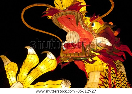 Close up of Colorful Dragon isolated on black background