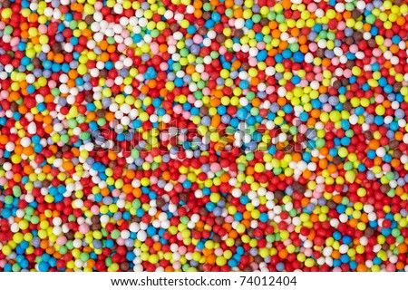close up of colorful eatable sugar pearls for food decoration - stock photo