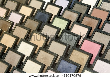 Close up of colorful eyeshadow palette group