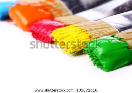 Close up of colorful paint and brushes
