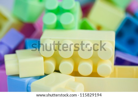 Close up of colorful plastic toy bricks.
