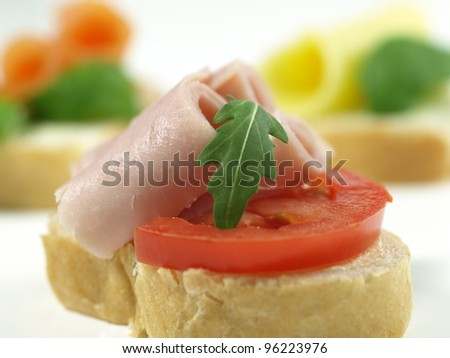 Close-up of colorful sandwich with ham and tomato