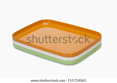Close-up of colorful trays representing Indian flag colors
