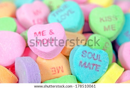 close up of colorful valentine candy hearts