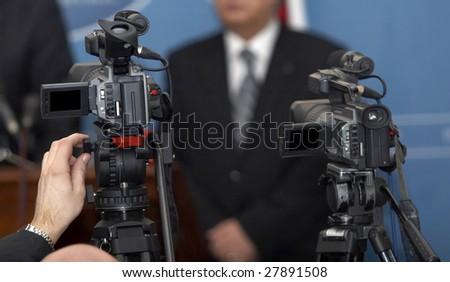 close up of conference meeting and broadcasting camera