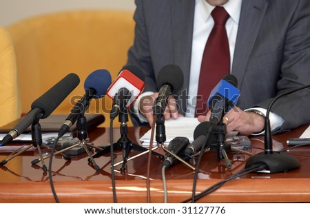 close up of conference meeting microphones