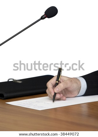 close up of conference meeting microphones and businessman writing isolated on white background