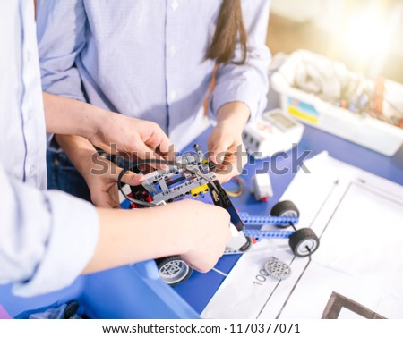 Close up of construction workflow of electronic car with microcontroller at junior robotics club. Collective child s creation of diy electronics, modern technologies, innovation and science concept #1170377071