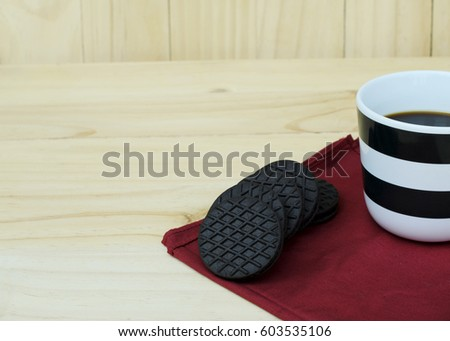 Close up of cookie with coffee cup on wooden backgrounds #603535106