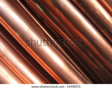 Close-up of copper pipes, abstract background