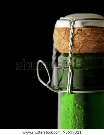 Close-up of cork on a closed bottle of  Champagne