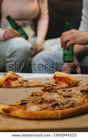 close up of couple eating pizza at home. evening scene Stock photo ©
