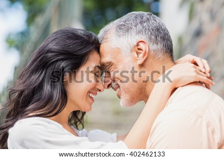 Close-up of couple embracing outdoors