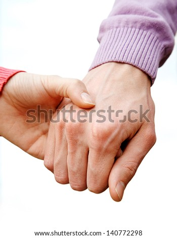 Close-up of couple holding by hands outdoor