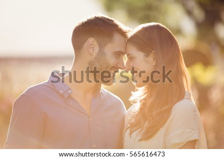 Close-up of couple romancing at park