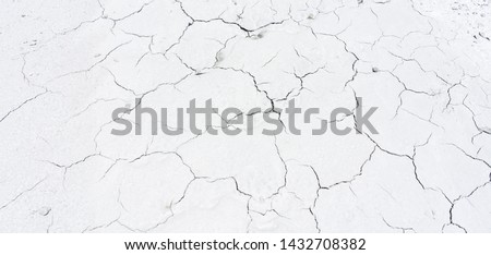 Close up of crack soil and muddy in the dry season textures, hot summer. Patterns and texture cracked soil of sunny dried earth soil, Drought of the ground. Dried cracked earth soil ground background