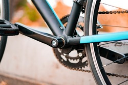 Close-up of crank for bicycle pedals with blurred background. Crankset. Cogwheels. Frame. Chain. Transport. Transportation. Cranks