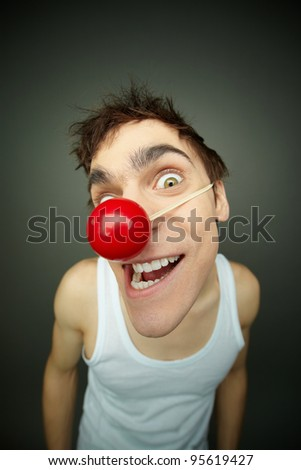 Close-up of crazy looking boy smiling at camera on fool�s day