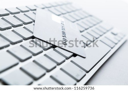 Close up of credit card on a computer keyboard. Concept of internet buying