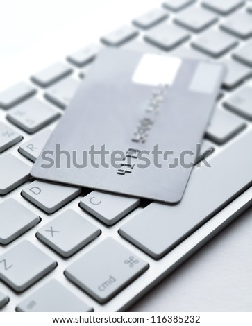 Close up of credit card on a laptop keyboard. Concept of internet buying