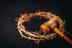 Close up of crown of thorns of Jesus and  Judge gavel on  black background. Christian back concept show God justice and Christ's redemption  concept