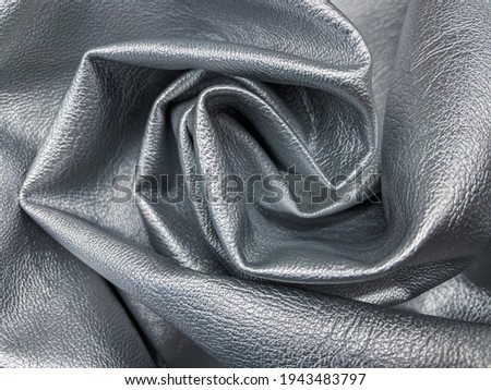 Close up of crumpled grained faux leather, dyed in silver colour. Photo stock ©