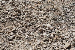Close up of crushed rock, stone raw material for construction industry. Stones for use as background and texture.