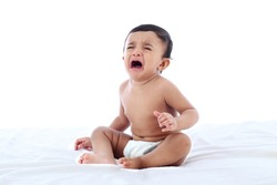 Close up of crying  baby on white background