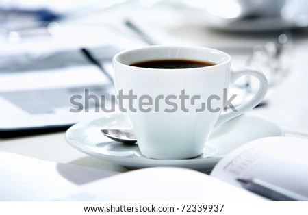 Close-up of cup of coffee on the table
