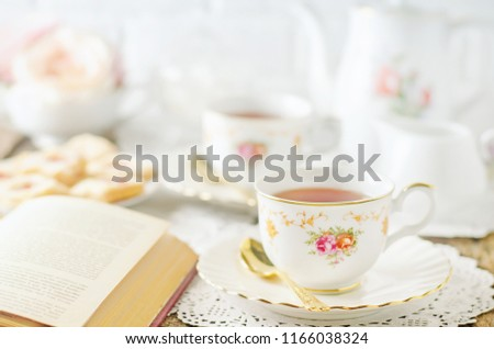 Close up of cup of tea on table with vintage tone - Afternoon tea party concept #1166038324