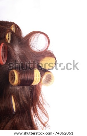 close-up of curlers in hair isolated on white