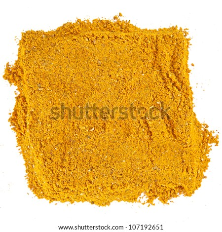 Close-up of curry spice isolated on white background.