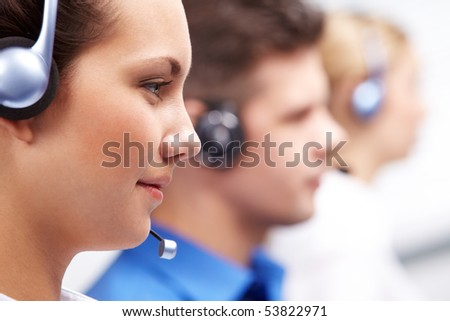 Close-up of customer support representative with headset during work