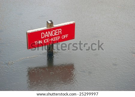 Close-up of danger sign in thawing ice