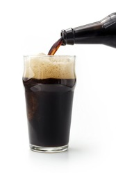close up of dark beer poured from the bottle