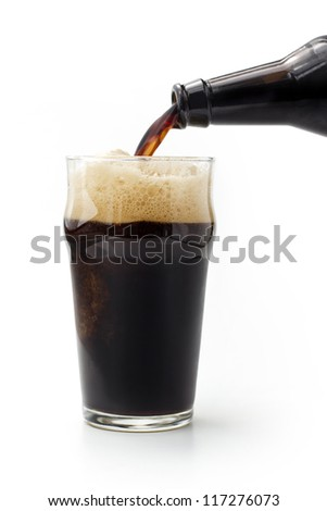 close up of dark beer poured from the bottle Stock photo ©