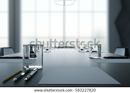 Close up of dark conference table with water glasses, pens, paper sheets and blurry window background. 3D Rendering