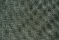 close up of dark green fabric texture. olive green cloth background.  Structure of the olive fabric with natural texture.