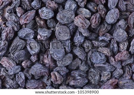 Close-up of dark raisins (currant). Top view point.