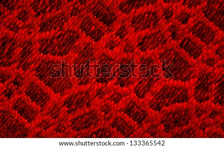 Close up of dark red colored wool textile in Hi-Res
