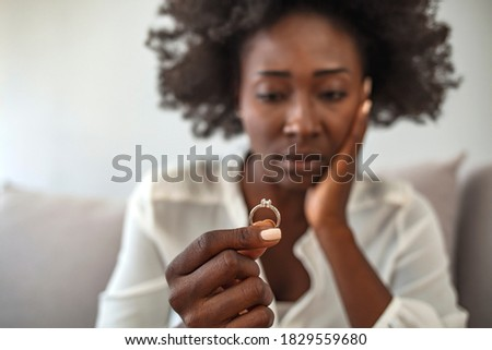 Close up of decisive woman take off wedding ring make decision breaking up with husband, young female remove engagement jewelry having relationships problems filing for divorce or annulment Photo stock ©