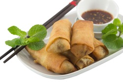 Close up of deep fried spring rolls on white background