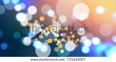 Close-up of defocused lights against snow covered trees #731643007