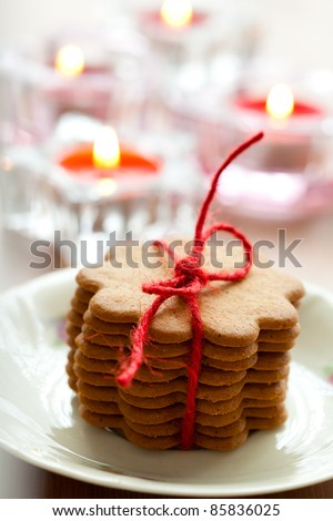 Close-up of delicious Christmas gingerbread cookies with candles
