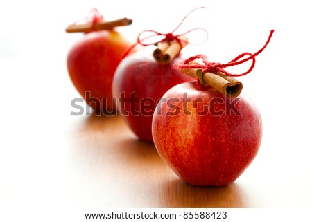 Close-up of delicious red Christmas apples with cinnamon sticks