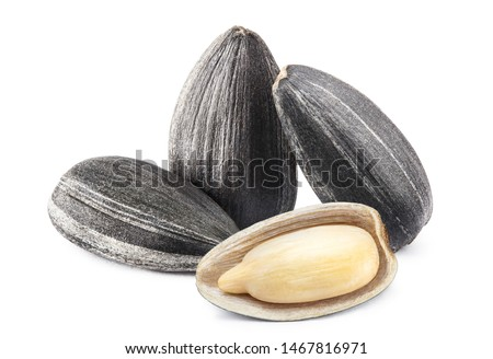 Close-up of delicious sunflower black seeds, isolated on white background ストックフォト ©