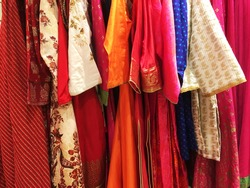 Close up of designer indian garments for woman displaying on the rack. Indian traditional women ware on display in the fashion store.