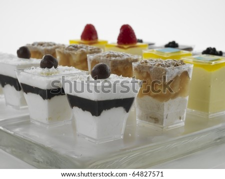 Close up of desserts on tray - stock photo
